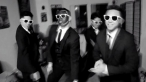 "A Lambda Theta Delta fraternity member wears blackface in a lip-syncing video to Justin Timberlake and Jay-Z's song ""Suit and Tie."" (The Daily Pilot / April 25, 2013)"